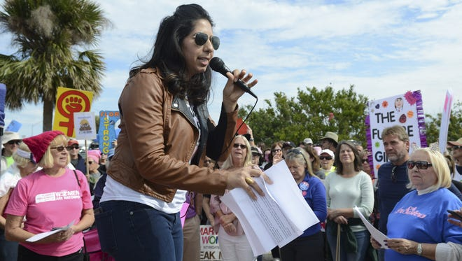 Thousands rally along the Eau Gallie Causeway during the 2018 Women's March. Anna Eskamani, Senior Director, Planned Parenthood of Southwest and Central Florida, speaks to the crowd during the march.