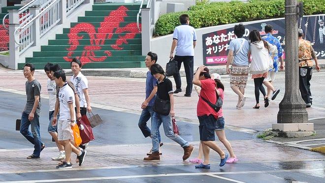 In this file photo, pedestrians use a cross2alk near DFS Galleria in Tumon.