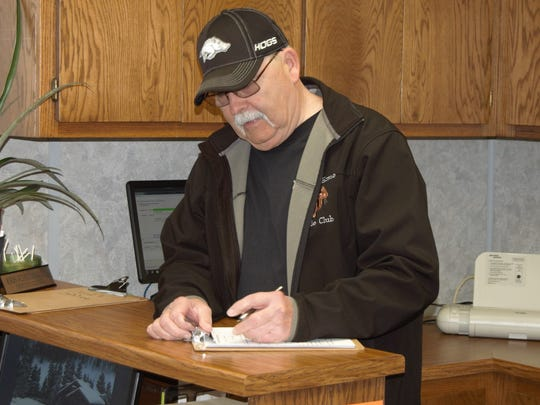 Democrat Tommy Steen fills out the paperwork to run as District 8 constable Thursday morning at the Baxter County Courthouse. Steen is unopposed for the position.