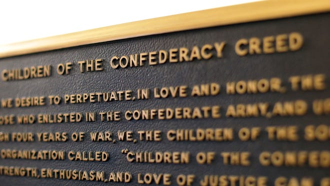 """A Confederate plaque is displayed near the Rotunda in the Texas State Capitol in Austin, Texas. A powerful Texas Republican is calling for the removal of the Confederate marker in the state Capitol that rejects slavery as an underlying cause of the Civil War. Republican House Speaker Joe Straus said Tuesday, Sept. 19, in a letter to state officials that the plaque is """"blatantly inaccurate."""" He says Texans aren't """"well-served by incorrect information about our history."""""""