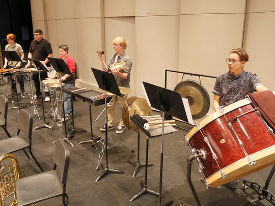 "The percussion ensemble of the San Juan College Symphonic Band will be spotlighted on a performance of composer Eric Rath's ""Escape Artist"" during tonight's concert."