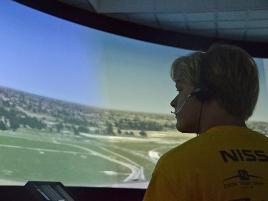 A young aviation camper takes a turn training Wednesday,