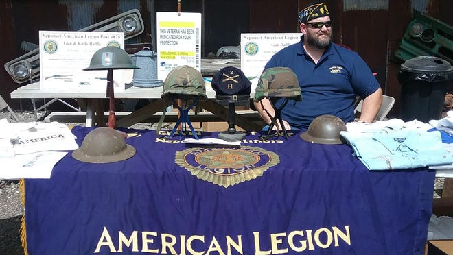 Neponset AmLegion Post Adjutant Rodney Bennett was recently at the Psycho Silo in Sheffield to sell tickets for an upcoming gun raffle. On display is head gear from the Civil War, WWI, WWII, Korean, Vietnam, Bosnia and Iraq.