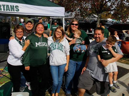 Football fans tailgated before the MSU homecoming game against Indiana on October 21, 2017, at Spartan Stadium in East Lansing.