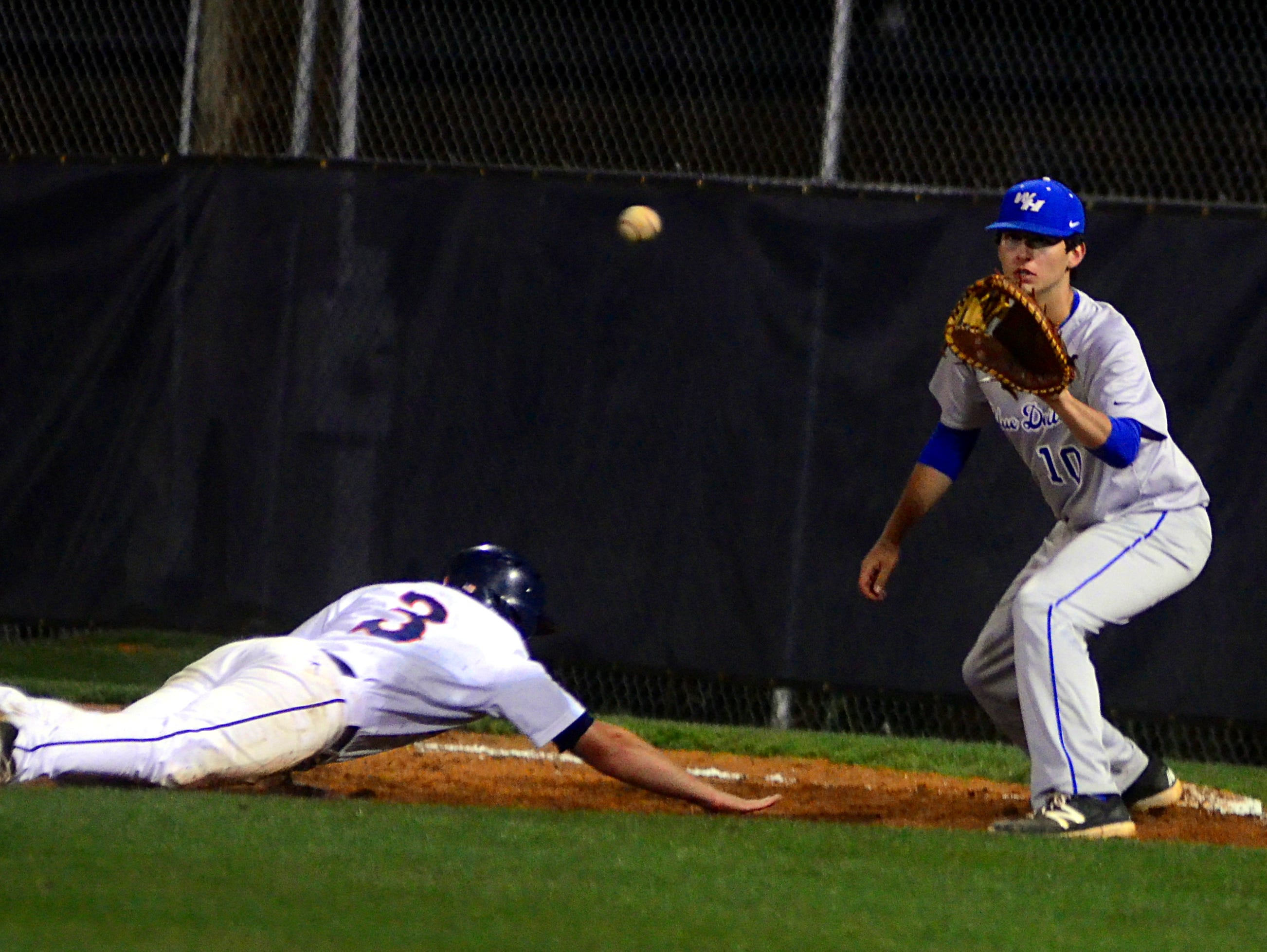 White House High senior Landon Sewell receives a pickoff throw as Beech senior Jesse McCoy dives back to first base during fourth-inning action.