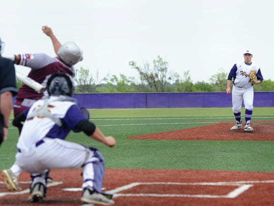 Wylie pitcher Blake Smith (45) looks on after collecting