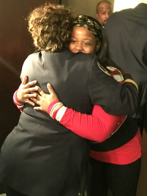 LaToya Spears, right, hugs one of the people who helped locate her son Marvie Gardner, 3, after he was kidnapped from his home on the city's west side last week. She was at a news conference on Friday, Oct. 28, 2016, at City Hall in Detroit.