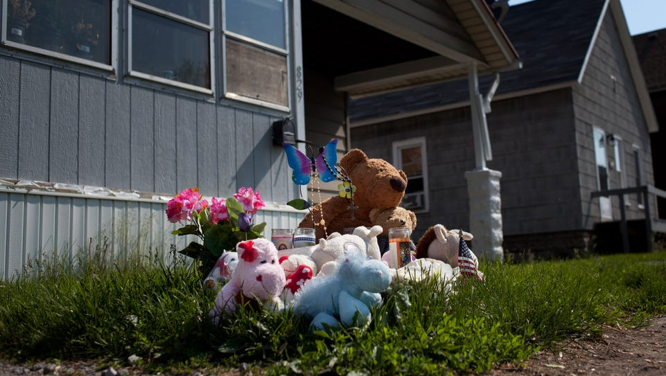 A memorial of candles, flowers and stuffed animals