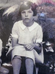 This picture shows Joanna Bard Newton as a child. She is now 100.
