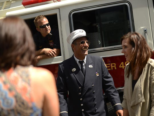 Retired FDNY Lt. Ray Thomas visits with firefighters