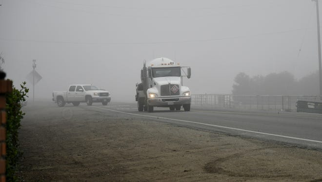 Cars drive on Road 140 near Sundale Union School District in Tulare on Tuesday.