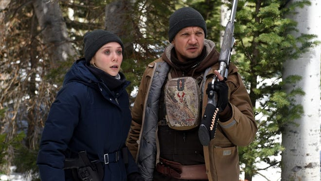 "Elizabeth Olsen and Jeremy Renner star in ""Wind River."""