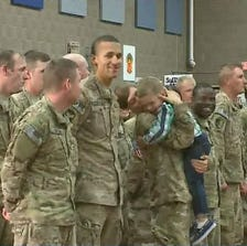 Toddler ignores military protocol, greets mom.