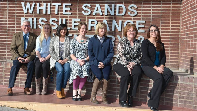 """White Sands School Principal Thomas Bulger, left, sits with a group of WSS teachers outside the school as the school celebrates their """"A"""" grade in the School Grade Report Card from the New Mexico Public Education Department. Pictured with Bulger from left: Jessica Orr, Bella Martinez, Kate Nichols, Laurie Atteberry, Kathi Bowman and Sandra Nunez."""