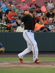 The Orioles' Chris Davis hits the ball during his at bat for the Delmarva Shorebirds during his rehab stint in Salisbury on Thursday, July 12, 2017.