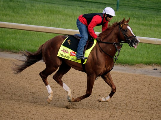 An exercise rider takes Kentucky Derby hopeful Pablo Del Monte for a morning workout at Churchill Downs Thursday, May 1, 2014, in Louisville, Ky. (AP Photo/Charlie Riedel)