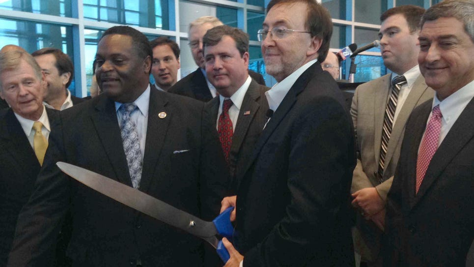 Monroe Mayor Jamie Mayo and CenturyLink CEO Glen Post