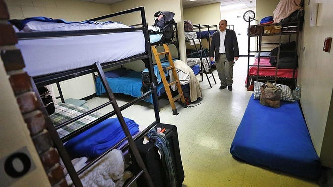 John  Yazwinski, CEO of Father Bill's & MainSpring, stands in the organization's emergency shelter in Quincy in 2019. Patriot Ledger file photo.