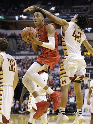 FILE -- New Albany Bulldogs Romeo Langford (1) drives by McCutcheon Mavericks Billy Loft (42) in the second half of the IHSAA 4A Boys Basketball State Final game Saturday, Mar 26, 2016, evening at Bankers Life Fieldhouse. The New Albany Bulldogs  defeated the McCutcheon Mavericks 62-59.