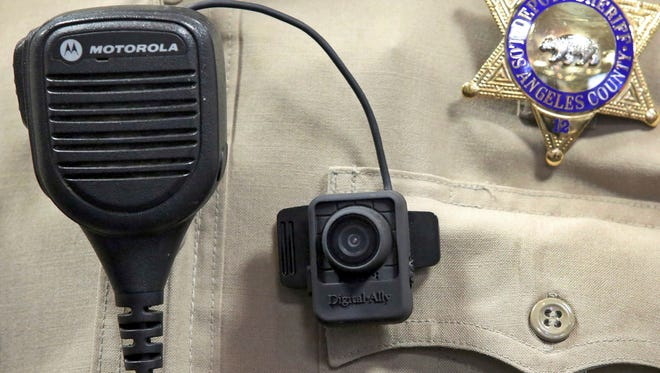 In this Sept. 22, 2014, file photo, a body camera is displayed at a news conference at the Los Angeles County Sheriff's Department  headquarters.