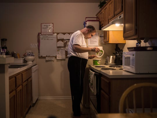 Ron Plewa 46, of Shelby Township checks on butter he