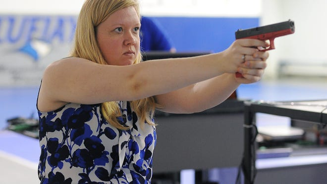 Argus Leader reporter Katie Nelson takes part in MILO Range interactive use-of-force training on Tuesday, July 21, 2015, at Minnesota West Community and Technical College in Worthington, Minn.