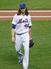 Mets starting pitcher Jacob deGrom (48) heads to the dugout after first inning against the Washington Nationals at Citi Field on Saturday, April 22, 2017.