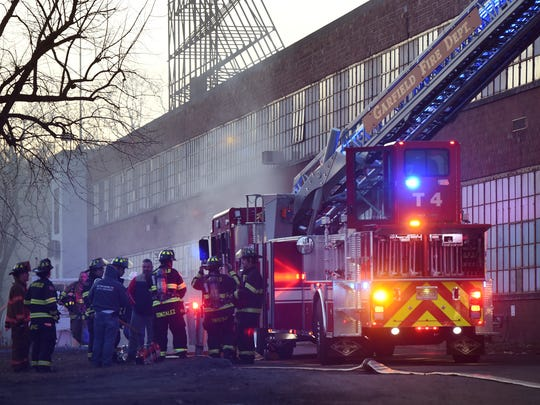More than 100 firefighters from 20 towns worked on extinguishing a fire at the Marcal paper plant in Elmwood Park on Monday.