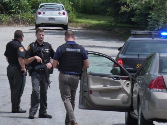 Law enforcement gathers on Sauder Drive off Washington-North