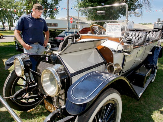 Dane Newcomb looks at a 1913 Buick touring car at the 2010 Altered Classics Car Show and Shine Saturday at Montana ExpoPark.