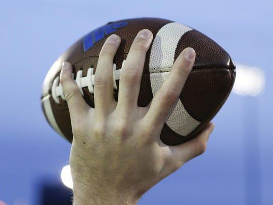 Delaware freshman quarterback Pat Kehoe demonstrates his football throwing grip.