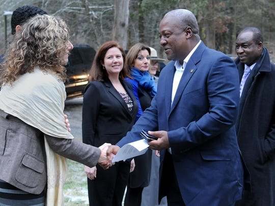 John Dramani Mahama, the president of Ghana, greets Erin Cannan, the associate director of the center for civic engagement at Bard College, before touring the Eleanor Roosevelt Historic Site at Val-Kill in Hyde Park. Also pictured are Uri Perrin, second from left, and Manuela Roosevelt.