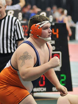 Galion's Deaken McCoy does a fist pump in victory after beating Middletown Bishop's Ryan Fessler in the 285lbs class at State Championships in Columbus Thursday.