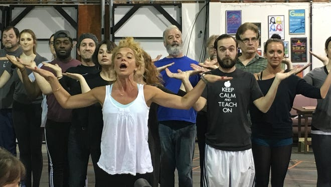 """Serena Magnan O'Connell as Mrs. Corry leads the cast in """"Supercalifragilisticexpialidocious"""" during a rehearsal for Lyric's """"Mary Poppins."""""""