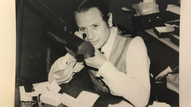 Company founder Harry Cornell, seen here examining a diamond in the early 1970s. Cornell lived to age 104.