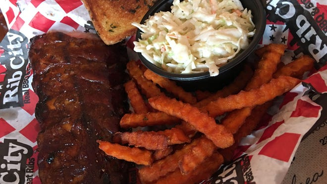 The ribs at Rib City in Grant are superb: beautifully smoky, tender without being mushy, slightly sweet, no fat or grease anywhere in sight, not sodden with sauce, but flavorful; perfect.