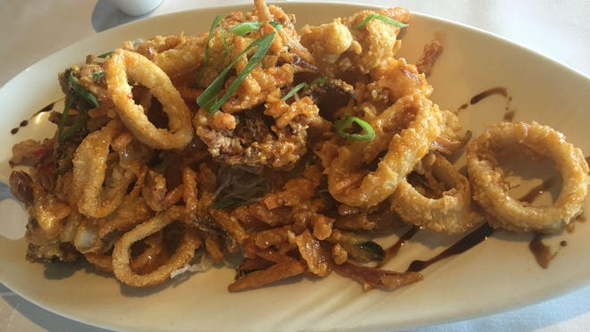 The Kim Chee Calamari was delicious: rings of calamari that were not tough or chewy, fried with sticks of various vegetables and dressed with an Asian-style sauce with the slightest of kicks.