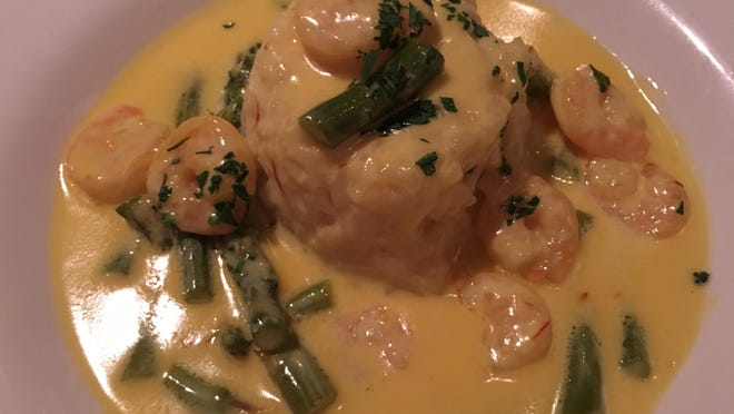 Saffron risotto timbale, studded with a few reddish saffron filaments along with shrimp and fresh asparagus.