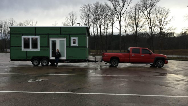 Joshua Slovensky's fiancé, Crescentia Danner, shows off the couple's tiny house, which is all of 8 1/2-feet wide by 24-feet long by 10-feet high.