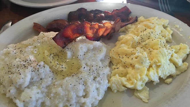 Scrambled eggs, bacon and grits.