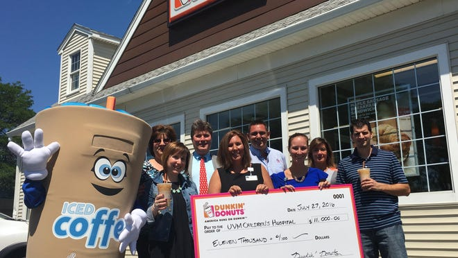 Local Dunkin' Donuts franchisees present a check for $11,000 to the Vermont Children's Hospital. The money was raised during Iced Coffee Day. From left: Donna Espinola (Dunkin' Donuts franchisee), Tamara Tenenbaum (Dunkin' Donuts field marketing manager), Ray Aley (Dunkin' Donuts franchisee), Jacqueline Woodwell (UVM Children's Hospital), Greg Sagris (Dunkin' Donuts franchisee), Shelby Allard (UVM Children's Hospital), Cheryl Aley, and Jeff Espinola (Dunkin' Donuts franchisees).