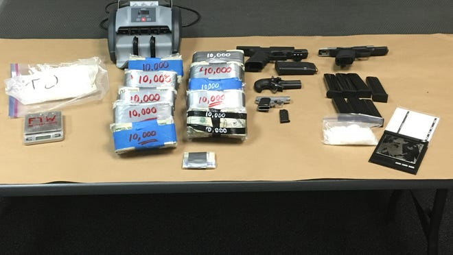 Drugs, cash and guns seized at a Salem home.