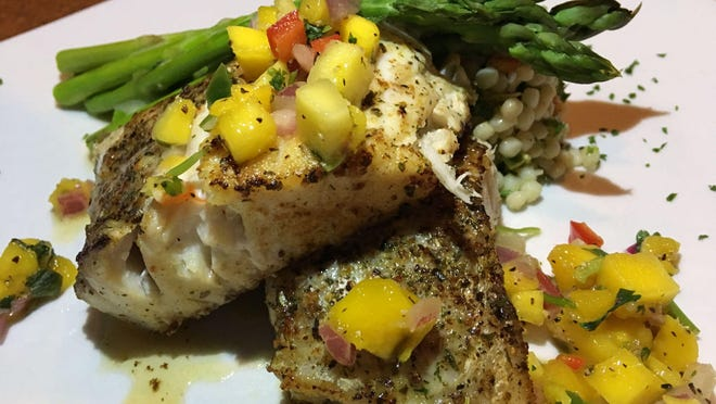 The corvina at Florida's Fresh Grill was perfectly prepared and gorgeously presented: a couple of planks of delicate, flaky fish, grilled and dressed with refreshing mango salsa, along with asparagus and herb-fragrant, citrus-tangy, Israeli (pearl) couscous.