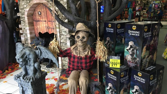 A scarecrow gets into the swing of Halloween Thursday at the Spirit Halloween store in Visalia.