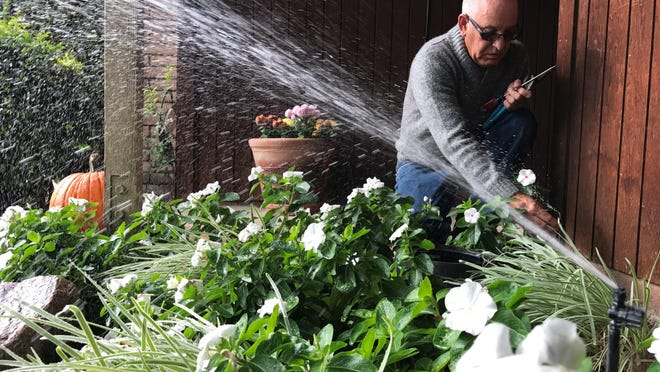 Cris Medeiros has rigged his sprinkler system to save water. He says he's shut off sprinklers used by the builder of his south Visalia home and uses a drip system and low-flow heads.