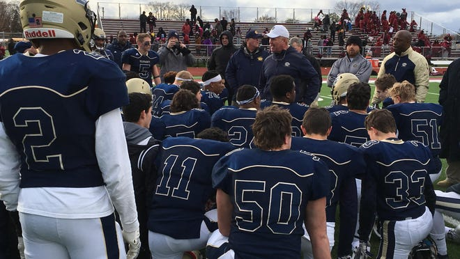 Birmingham Detroit Country Day coach Dan MacLean talks to his team after a 20-14 win over River Rouge in the Div. 4 state semifinals Saturday, Nov. 19, 2016.