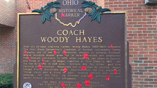 Red tape covers the Ms on the official state Ohio historical marker recognizing former Ohio State NCAA college football coach Woody Hayes at the Woody Hayes Football Center on the Ohio State University campus in Columbus, Ohio.