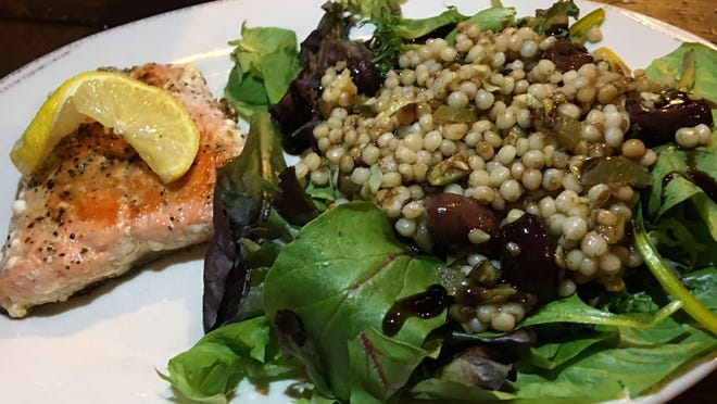 Grilled salmon and couscous salad featured perfectly grilled fish served with Israeli couscous dressed with tangy lemon vinaigrette.