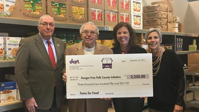 Des Moines Area Regional Transit CEO Elizabeth Presutti presents a $3,250 check to the Polk County Supervisors on Dec. 14 at the Polk County River Place food pantry. Presutti, third from left, is pictured with supervisors, from left, Steve Van Oort, John Mauro and Angela Connolly. The money was collected on DART's annual Fares for Food Day Dec. 8 to support Partnership for Hunger Free Polk County.