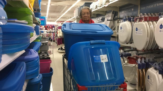 Barbara Walker found containers to store her Christmas decorations, but had trouble finding lids to fit, Thursday at the Garden City Kmart.